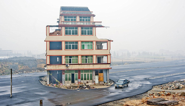 House-in-middle-of-road-3